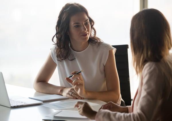 An insurance professional interviews a customer